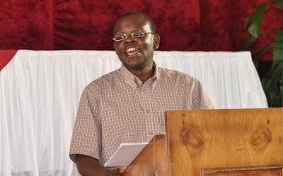 16 - Isaac Makashinyi leading worship
